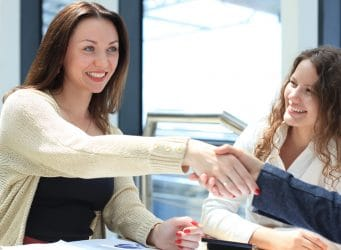 Side view of executives shaking hands during a business meeting