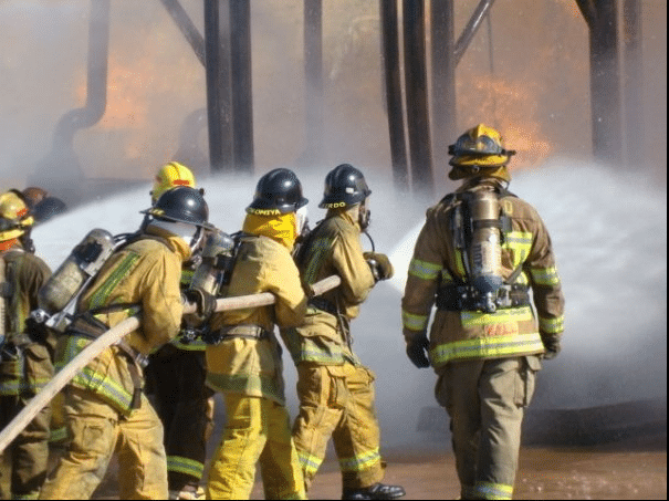 Firefighters with water hose (2)