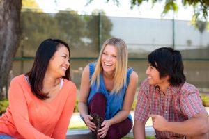 Three students talking