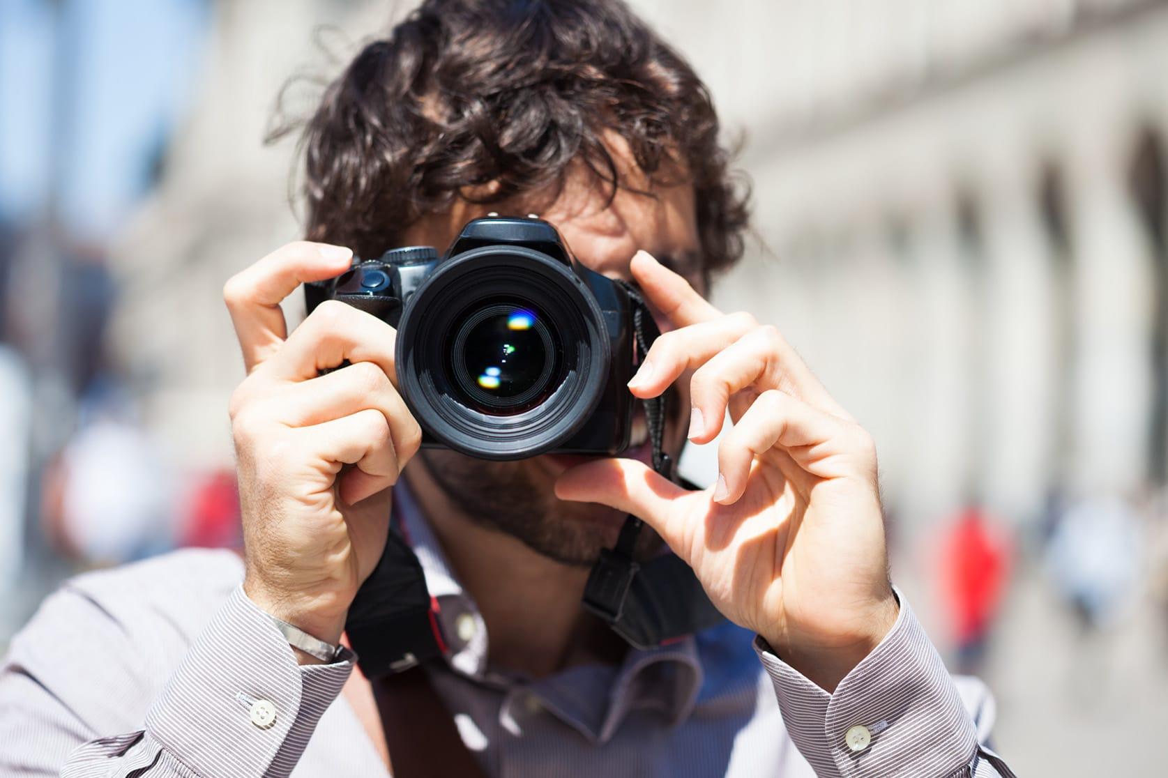Man shooting photograph